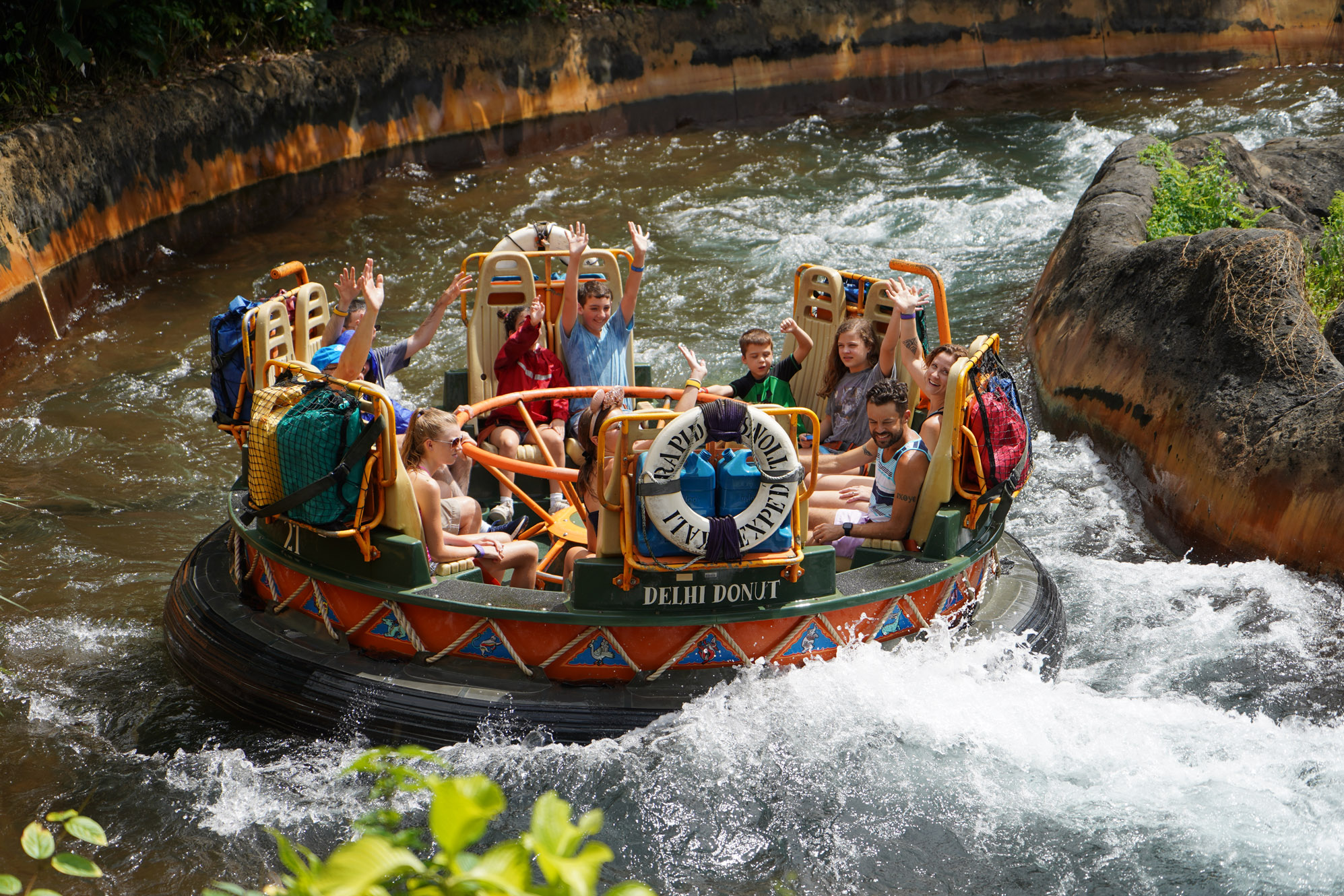 Scool group riding Disney World's Kali River Rapids